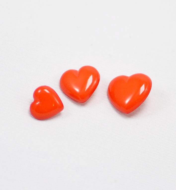 πλαστικό παιδικό κουμπί καρδιά κοραλί